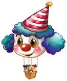 Ein großer Clownballon mit einem Korb voll von den Kindern Stockfotografie