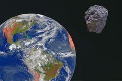 Ein großer Meteor wird für Erde vorangegangen Ein Meteorit gegen den Erde-` s Hintergrund lizenzfreie stockfotos