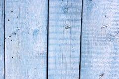 Ein hölzerner gemalter blauer Hintergrund Eine blaue hölzerne Wand stockbild
