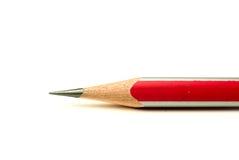 Ein hölzernes Bleistiftrot an über Weiß Lizenzfreie Stockfotografie