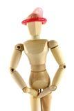 Ein hölzernes Mannequin mit Kondom auf seinem Kopf Lizenzfreie Stockfotos