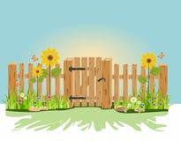 Ein hölzernes Tor und ein Zaun Stockbild