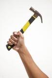 Ein Hammer, der durch eine Hand hält Stockbild