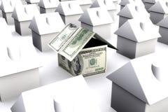 Ein Haus gemacht von den Gelddollar, umgeben durch Weiß Stockfoto