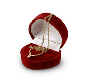 Ein Herz aus Gold in einem Samtkasten Stockbild