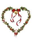Ein Herz der Stechpalme mit Weihnachtsdekoration Stockfotografie