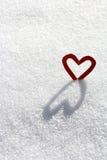 Ein Herz mit Schatten Stockfotografie
