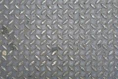 Ein Hintergrund der alten Metalldiamantplatte Stockbild