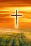 Kreuz am Sonnenuntergang Stockbild