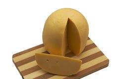 Ein holländischer Käse mit Teil weg Stockfoto