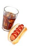 Ein Hotdog und ein Sodaglas Lizenzfreies Stockbild