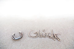 Ein Hufeisen im Sand Lizenzfreie Stockfotografie