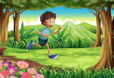 Ein Junge, der am Dschungel läuft Stockfotos