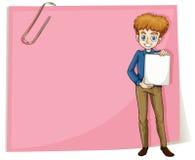 Ein Junge, der einen leeren Signage steht vor einem leeren Brei hält Lizenzfreie Stockbilder