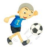 Ein Junge, der Fußball spielt Stockfotos