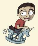 Ein Junge, der sein Schwingpferd reitet Stockbilder