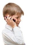 Ein Junge mit einem Handy Lizenzfreies Stockfoto