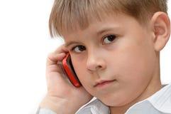 Ein Junge mit einem Handy Stockfotografie