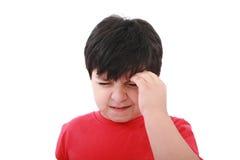 Ein Junge mit Kopfschmerzen; getrennt lizenzfreies stockbild