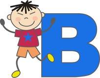Ein Junge mit Zeichen B Stockfotografie