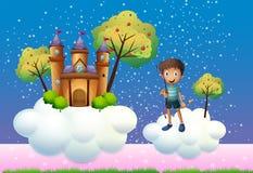 Ein Junge und ein sich hin- und herbewegendes Schloss Stockfotos
