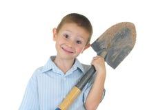 Ein Junge und seine Schaufel lizenzfreies stockbild