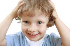 Ein Jungenlächeln Stockbilder