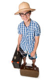 Ein junger, attraktiver homosexueller Kerl mit Gläsern und zwei Koffer bereit Stockfotografie
