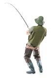 Ein junger euphorischer Fischer Lizenzfreies Stockfoto