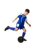 Ein junger Jungenfußballspieler Stockfotografie