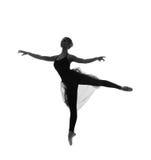 Ein junger kaukasischer Balletttänzer in einem schwarzen Kleid Lizenzfreies Stockfoto