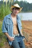 Ein junger männlicher Cowboy Stockfoto