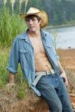 Ein junger männlicher Cowboy stockfotografie