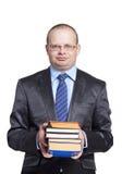 Ein junger Mann in den Gläsern, die Bücher halten Lizenzfreies Stockfoto