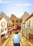 Ein junger Mann mit einem Hut, der zur Saalstange geht Lizenzfreies Stockfoto