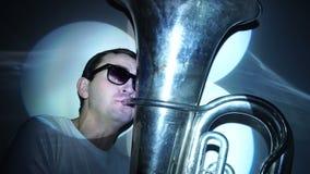 Ein junger Mann spielt die Tuba stock footage