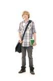 Ein junger Teenager, der in der Schulekleidung aufwirft Lizenzfreie Stockfotos