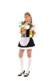 Ein junges bayerisches Mädchen, das in der traditionellen Kleidung aufwirft Lizenzfreies Stockbild