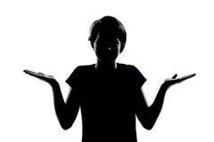 Ein junges ignorantes Zögern des Jugendlichjungen- oder -mädchenschattenbildes SH stockbilder