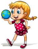 Ein junges Mädchen, das eine Kugel hält Stockbilder