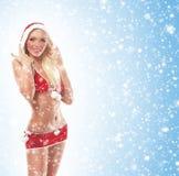 Ein junges und sexy blondes in der Weihnachtswäsche Lizenzfreie Stockbilder