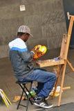 Ein Künstler malt die Köln-Kathedrale Stockfotos