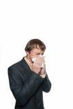 Ein kalter Mann mit einem Taschentuch Stockfotografie