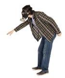 Lokalisierte Mann-tragende Gasmaske und Erreichen Stockbild
