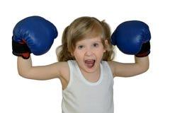 Ein Kind des kleinen Mädchens, Kind in den Boxhandschuhen Stockbild