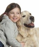 Ein Kind mit ihrem Hund Lizenzfreie Stockfotografie