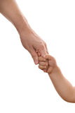 Ein Kind, welches ein die Hand anhält Lizenzfreies Stockfoto