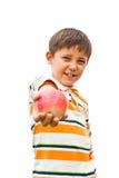 Ein kleiner Junge mit einem Apfel Stockbild
