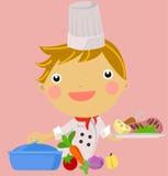 Ein kleiner Junge settingin eine Küche Lizenzfreies Stockfoto