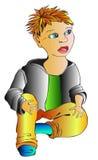 Ein kleiner Junge sitzt stockbilder